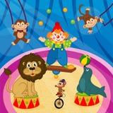 马戏的竞技场与动物和小丑 免版税库存照片