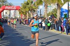 马拉松长跑的痛苦 库存图片