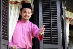 马来的回教人wavings手 免版税图库摄影