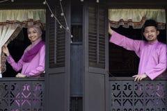 马来的回教夫妇微笑 库存图片