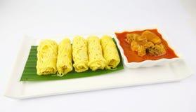 马来西亚人白色板材的Roti Jala 免版税库存照片