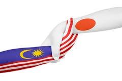 马来西亚和日本的帮手 免版税库存照片