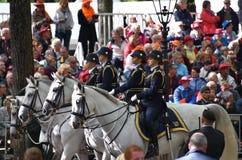 马的四位妇女战士在Prinsjesdag 免版税库存图片
