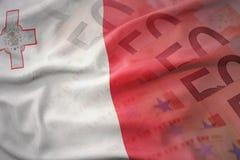 马耳他五颜六色的挥动的国旗欧元金钱钞票背景的 图库摄影
