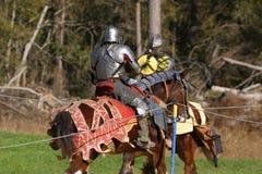 马背射击的骑士 库存图片