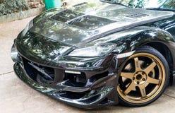 马自达RX8佩带Volk光芒TE37金黄18英寸外缘 免版税库存图片