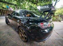 马自达RX8佩带Volk光芒TE37金黄18英寸外缘 库存图片