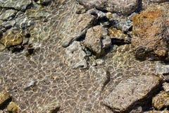 马赛克在被淹没的岩石的背景样式 免版税图库摄影