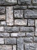 马赛克石头阻拦墙壁 免版税库存照片