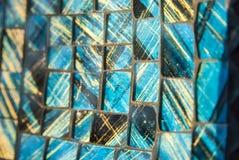 马赛克蓝色阿那黑色背景 玻璃片断 库存照片