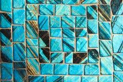 马赛克蓝色阿那黑色背景 玻璃片断 免版税图库摄影