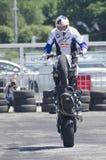 马达自行车杂技 免版税库存图片