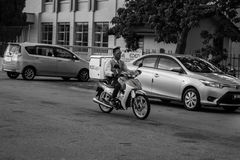 马达骑自行车者 库存照片