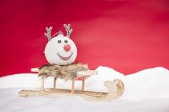 驯鹿中看不中用的物品坐雪橇 库存照片