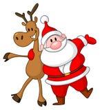 驯鹿和圣诞老人 库存照片