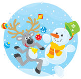 驯鹿和雪人跳舞 库存照片