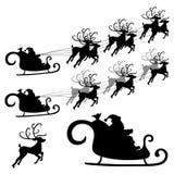 驯鹿圣诞老人剪影 免版税库存图片