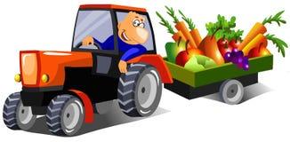 驱动农夫愉快的拖拉机 免版税图库摄影