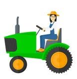 驱动农夫拖拉机 库存图片