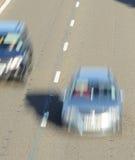驱动在机动车路的快速车 免版税库存照片