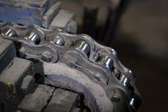 驱动胶辊链子和扣练齿轮 库存照片