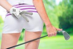 驴子与高尔夫俱乐部的高尔夫球运动员特写镜头在手中 库存图片