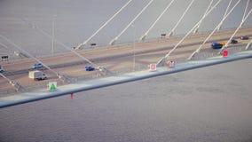 驾车在背景阴云密布天空和海寄生虫视图的高速公路桥梁 影视素材