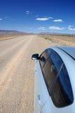 驾车在远程高速公路 免版税库存照片