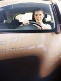 驾车妇女 免版税库存照片