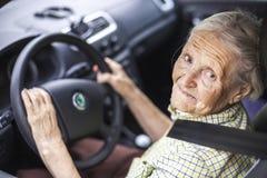 驾车高级妇女 免版税图库摄影