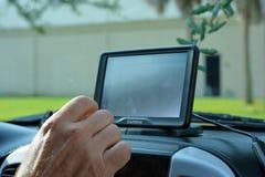 驾驶与Garmin GPS 库存照片