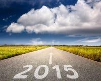 驾驶在一条空的路到即将来临2015年 免版税库存照片