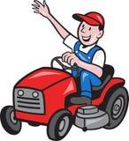 驾驶在刈草机拖拉机的农夫乘驾 库存照片