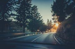 驾驶在日落 图库摄影