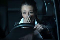 驾驶在晚上的Distracted 免版税库存照片