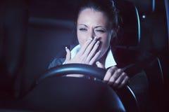 驾驶在晚上的Distracted 库存照片