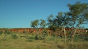 驾驶在有bushland的爆沸路到边 影视素材