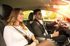 驾驶在汽车的美好的企业夫妇 图库摄影