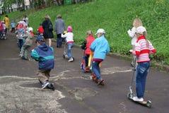 驾驶在滑行车的孩子在俄罗斯 库存图片