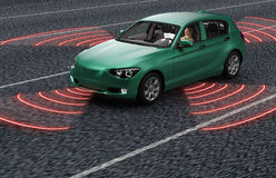 驾驶在路的自已电子计算机汽车 免版税图库摄影
