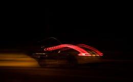 驾驶夜街道 库存照片
