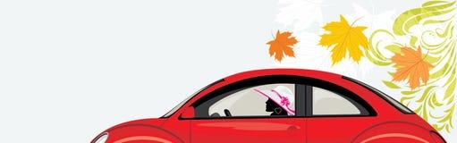 驾驶妇女在抽象背景的一辆红色汽车 免版税库存照片