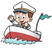 驾驶小船的男孩 库存图片