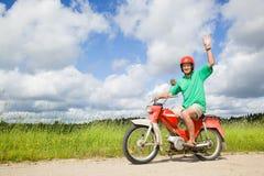 驾驶愉快的人脚踏车 库存图片