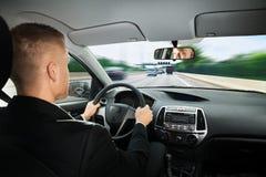 驾驶汽车的商人 免版税库存照片