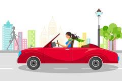 驾驶汽车的美丽的妇女 免版税库存照片