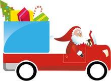 驾驶礼品圣诞老人卡车的克劳斯 免版税库存图片