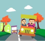 驾驶远离城市的父亲和儿子 库存照片