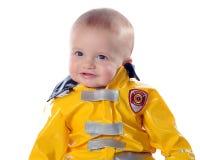 骄傲小的消防员 库存图片