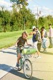 骑一辆自行车的年轻男孩在法国 库存图片
